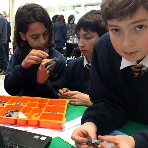 High school students using Lego