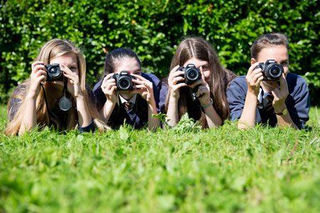 Photography students using cameras