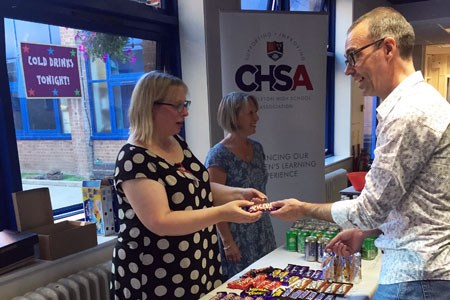 CHSA volunteer serving refreshments